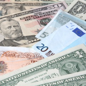 Money. World currencies: U.S. dollars, pounds and euros.